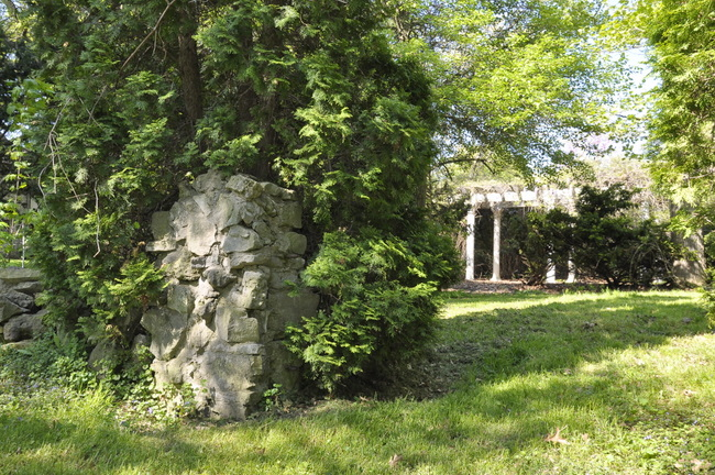 secret garden stone pillar and pergola