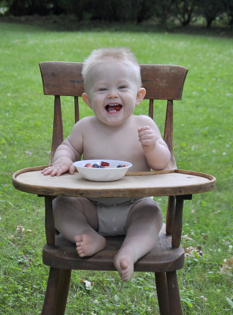 baby laughing in vintage high chair