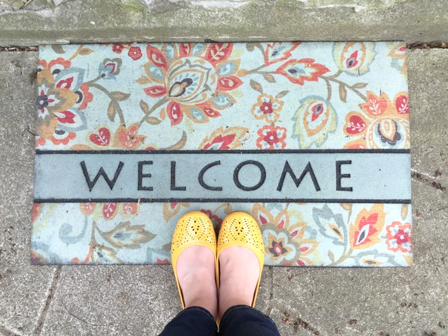yellow shoes and welcome mat
