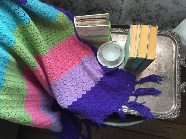 The colorful handmade blanket belonged to my great-aunt. Isn't it darling!