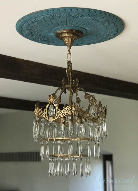 One of my favorite yard sales finds was this $20 vintage crystal chandelier and ceiling medallion!