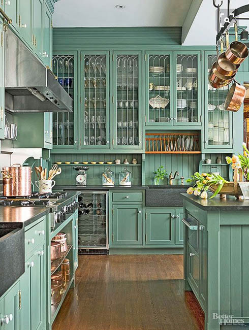 I first saw this kitchen before we even bought our little castle, and I keep thinking about it! The color, leaded glass cabinets, and copper pots thrill my very soul! Image by Better Homes and Gardens