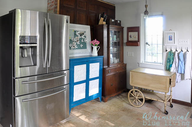 I love how my blue painted pie safe adds color to our kitchen! It was one of the first pieces of furniture I've ever painted and I love it just as much today as I did when I painted it almost 10 years ago!