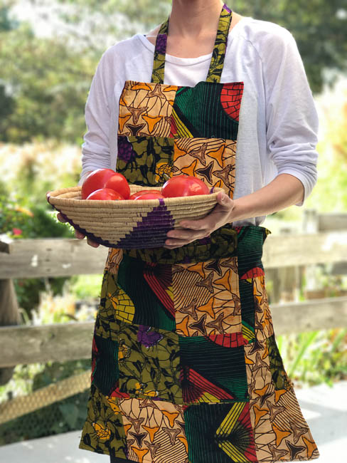 Apron made by the students at the vocational school and basket made by local artists in Uganda.